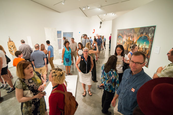 Group of people enjoying one of the art galleries during First Friday in Las Vegas