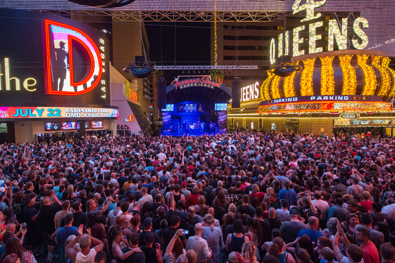 Live performance in Downtown Las Vegas with a large crowd between the D and the 4 Queens