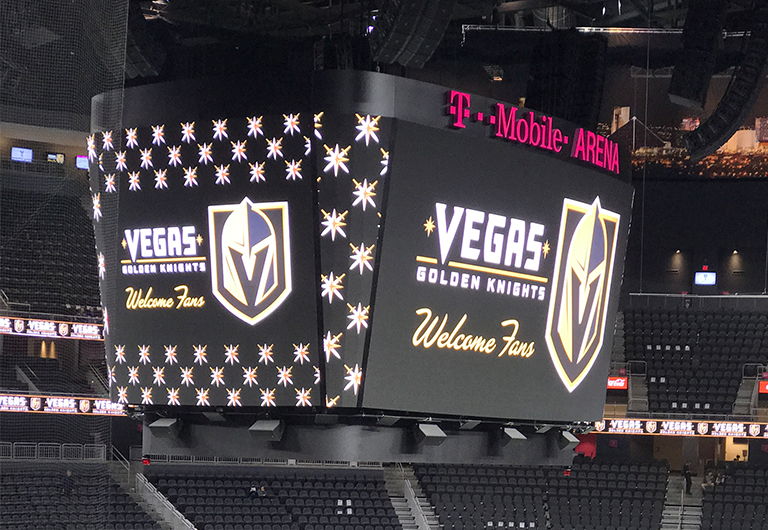 The jumbotron at the T-Mobile Arena with the Vegas Golden Knights logo on it, welcoming fans