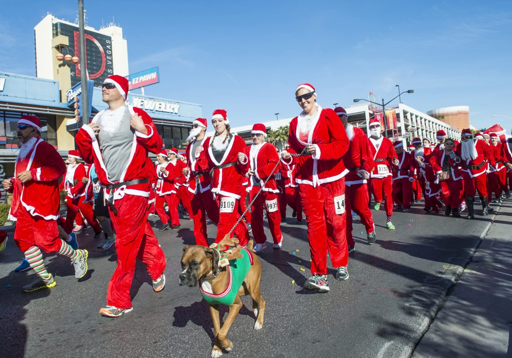 People dressed up as Santa Claus and participating in the Santa Claus run in Downtown Las Vegas