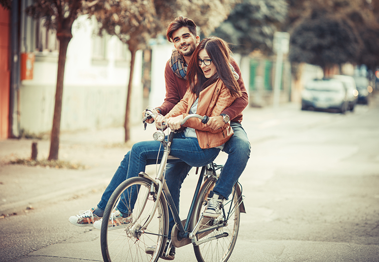 Happy couple enjoying a bike ride together.