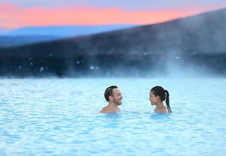 Couple Enjoying Sunset in Nevada Hot Spring.