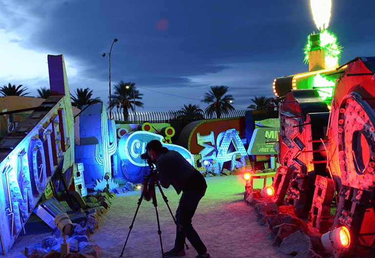 Observer taking pictures of the signs displayed at the Neon Museum.
