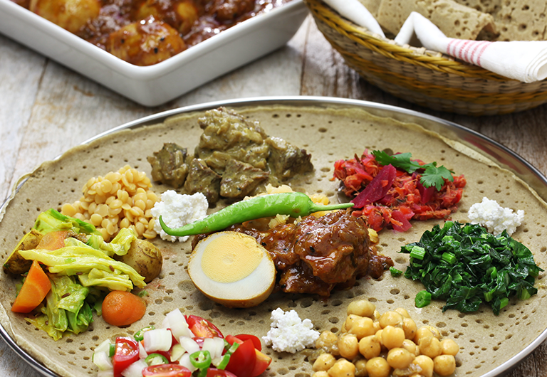 Platter of Ethiopian beans, veggies, and grains.
