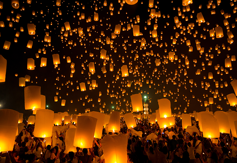 Lanterns flying into the sky at Las Vegas festival.
